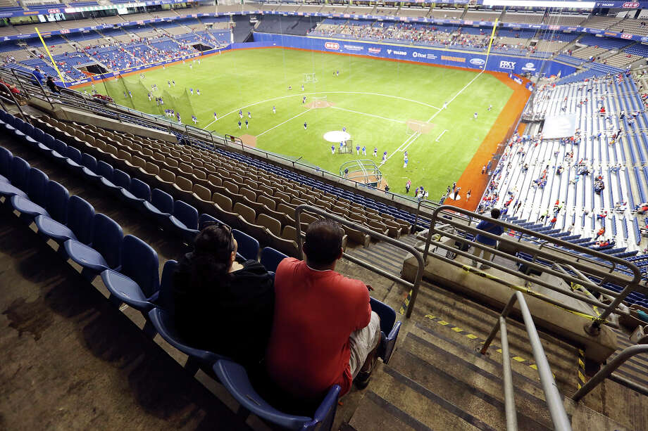 Baseball fans Margaret (left) and Paul Acosta watch batting practice before the Texas Rangers and San Diego Padres game part of the ÒBig League WeekendÓ Friday March 29, 2013 at the Alamodome. Photo: Edward A. Ornelas, San Antonio Express-News / © 2013 San Antonio Express-News