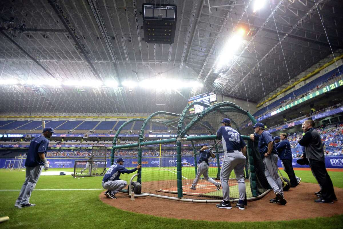 The San Diego Padres take pre game batting practice under the Alamodome lights during Big League Weekend at the Alamodome on Friday, March 29, 2013. A second game will be played on Saturday afternoon.