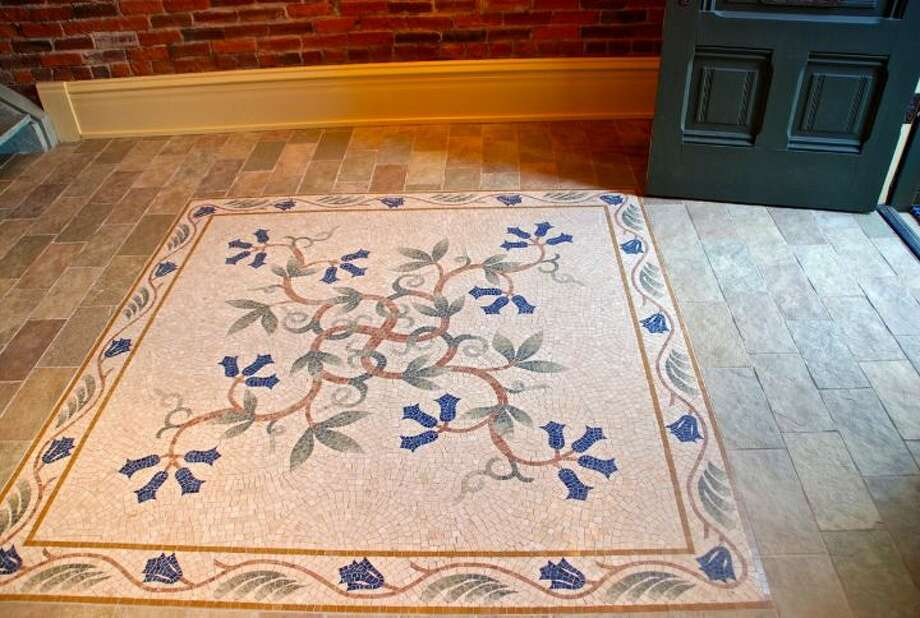 Floor detail of 819 Washington St., in Port Townsend. The 2,700-square-foot brick building, erected as a cracker factory in in 1888, has one bedroom suite, which takes up the entire third floor, 1.25 bathrooms, a ground-floor workspace, exposed brick walls, wood ceilings, a carved limestone fireplace and a roof deck. It's listed for $937,770. Photo: Josh Phoenix/HD Estates,  Courtesy Michelle Sandoval/Windermere Real Estate