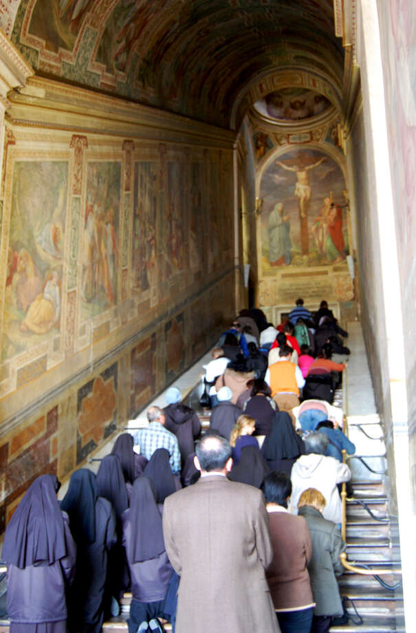 Each day in Rome, hundreds of faithful penitents climb the Holy Stairs of Scala Santa on their knees, reciting a litany of prayers. Photo: Rick Steves, Ricksteves.com