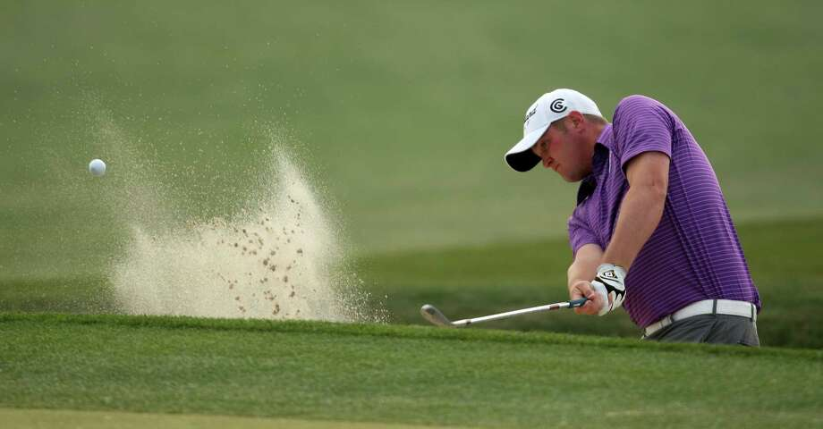Jason Kokrak hits out of a green side bunker on No. 8 during the second round of the Shell Houston Open, Friday, March 29, 2013 at the Redstone Tournament Course in Humble. (Photo: Eric Christian Smith/For the Houston Chronicle) Photo: Eric Christian Smith, For The Chronicle