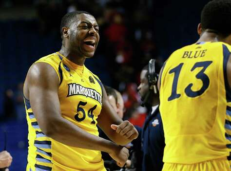 Marquette's Davante Gardner, left, proved to be too big a load for Syracuse in their last meeting Feb. 25. Photo: Kevin C. Cox, Staff / 2013 Getty Images