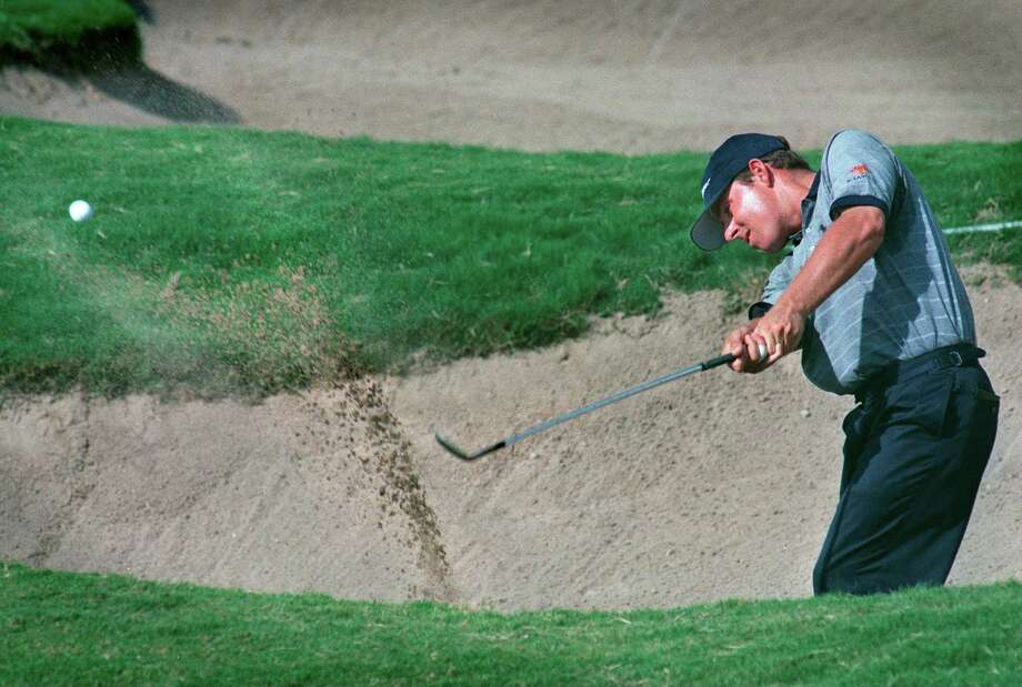 Justin Leonard blasts out of a fairway bunker on number 12 at the 1998 Westin Texas Open. Leonard won three titles in San Antonio beginning in 2000. Photo: TOM REEL, EN