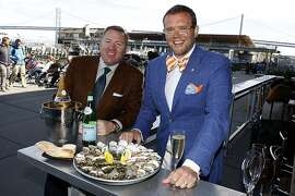 Founders of Pebble Beach Food & Wine event Rob Wheatley (left) and Dave Bernahl (right) have oysters at the Hog Island Oyster bar at the Ferry building in San Francisco, California on Tuesday, March 26, 2013.