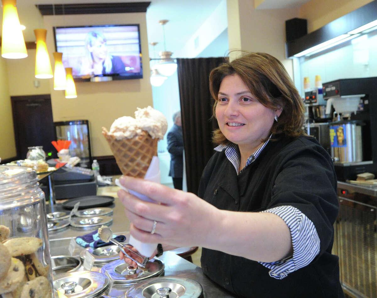 Simona Silvestri serves gelato in a cone in her store, La Fenice, at 315 Greenwich Ave., Thursday, March 28, 2013. The shop specializes in gelato and Italian pastries.