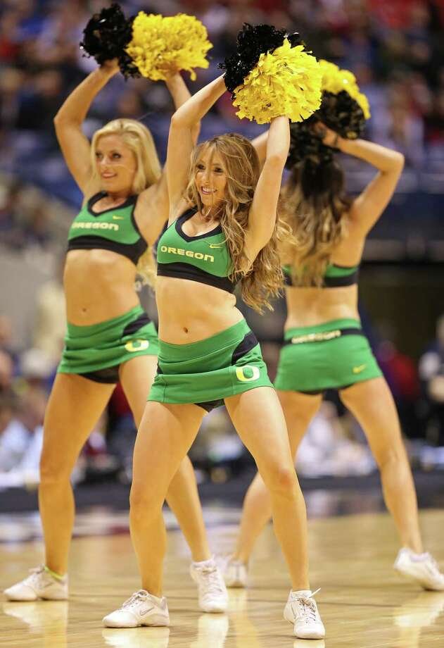 INDIANAPOLIS, IN - MARCH 29:  Cheerleaders for the Oregon Ducks perform in the first half against the Louisville Cardinals during the Midwest Region Semifinal round of the 2013 NCAA Men's Basketball Tournament at Lucas Oil Stadium on March 29, 2013 in Indianapolis, Indiana. Photo: Andy Lyons, Getty Images / 2013 Getty Images