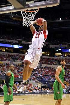 INDIANAPOLIS, IN - MARCH 29:  Chane Behanan #21 of the Louisville Cardinals attempts a dunk against the Oregon Ducks during the Midwest Region Semifinal round of the 2013 NCAA Men's Basketball Tournament at Lucas Oil Stadium on March 29, 2013 in Indianapolis, Indiana. Photo: Andy Lyons, Getty Images / 2013 Getty Images