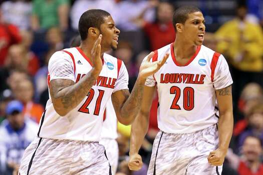 Louisville 77, Oregon 69INDIANAPOLIS, IN - MARCH 29:  (L-R) Chane Behanan #21 and Wayne Blackshear #20 of the Louisville Cardinals react in the first half against the Oregon Ducks during the Midwest Region Semifinal round of the 2013 NCAA Men's Basketball Tournament at Lucas Oil Stadium on March 29, 2013 in Indianapolis, Indiana. Photo: Andy Lyons, Getty Images / 2013 Getty Images