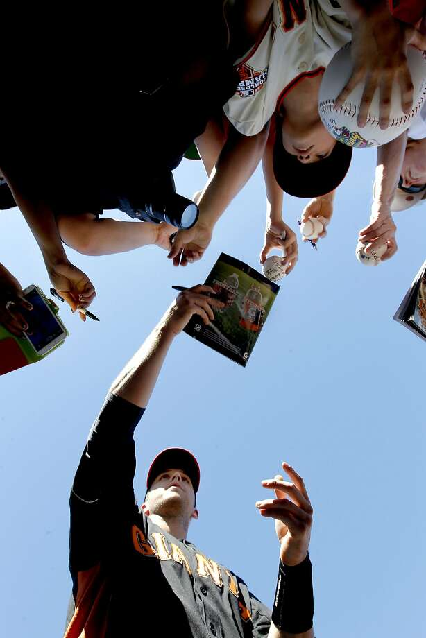 Giants' Buster Posey,(28) signs autographs for fans before the start of the game,as the San Francisco Giants take on the World Baseball Classic team from Japan in an exhibition game on Thursday Mar. 14, 2013, in Scottsdale, Az., in Spring Training action. Photo: Michael Macor, The Chronicle