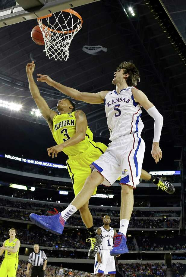 Michigan's Trey Burke (3) shoots past Kansas' Jeff Withey during the second half of a regional semifinal game in the NCAA college basketball tournament, Friday, March 29, 2013, in Arlington, Texas. (AP Photo/David J. Phillip) Photo: David J. Phillip, Associated Press / AP