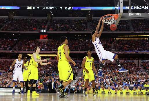 ARLINGTON, TX - MARCH 29:  Kevin Young #40 of the Kansas Jayhawks dunks on the Michigan Wolverines in the first hafl during the South Regional Semifinal round of the 2013 NCAA Men's Basketball Tournament at Dallas Cowboys Stadium on March 29, 2013 in Arlington, Texas. Photo: Ronald Martinez, Getty Images / 2013 Getty Images