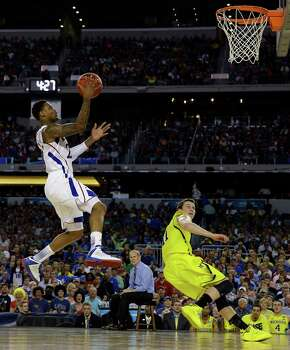 Kansas' Ben McLemore shoots over Michigan's Nik Stauskas during the first half of a regional semifinal game in the NCAA college basketball tournament, Friday, March 29, 2013, in Arlington, Texas. (AP Photo/David J. Phillip) Photo: David J. Phillip, Associated Press / AP