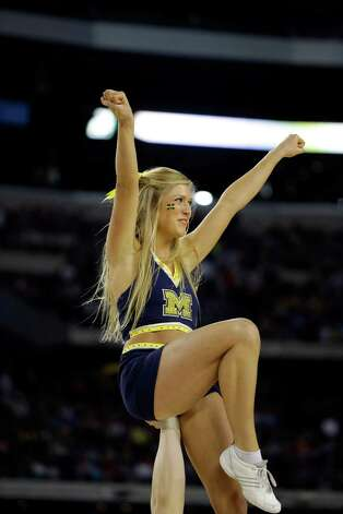 Michigan cheerleaders perform during the first half of a regional semifinal game against Kansas in the NCAA college basketball tournament, Friday, March 29, 2013, in Arlington, Texas. (AP Photo/David J. Phillip) Photo: David J. Phillip, Associated Press / AP