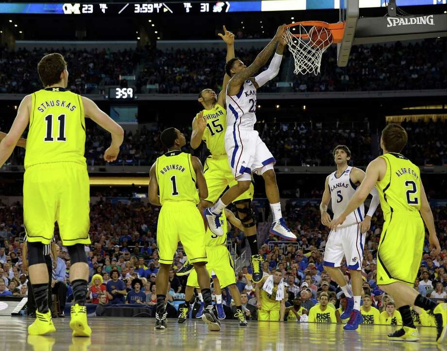 Kansas' Ben McLemore dunks during the first half of a regional semifinal game against Michigan in the NCAA college basketball tournament, Friday, March 29, 2013, in Arlington, Texas. (AP Photo/David J. Phillip) Photo: David J. Phillip, Associated Press / AP