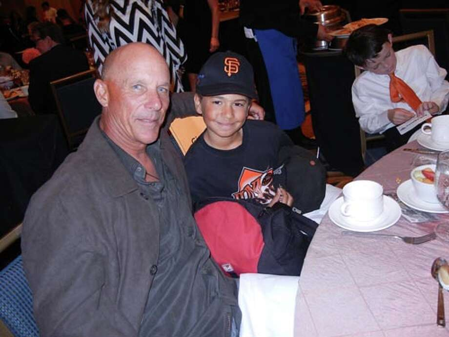 SF Giants Coach Tim Flannery and Junior Giant Divonne Garda at the Play Ball Lunch