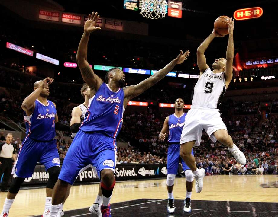 The Spurs' Tony Parker (9) takes a short jumper against Los Angeles Clippers' DeAndre Jordan (6) in the first quarter at the AT&T Center on Friday, Mar. 29, 2013. Photo: Kin Man Hui, San Antonio Express-News / © 2012 San Antonio Express-News