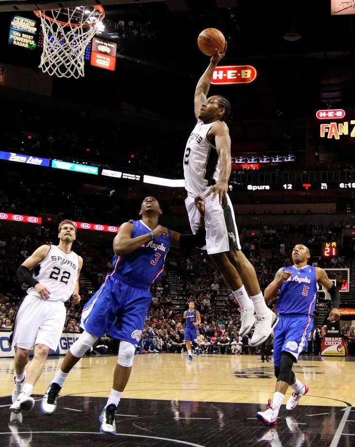The Spurs' Kawhi Leonard (2) attempts a dunk against Los Angeles Clippers' Chris Paul (3) in the first quarter at the AT&T Center on Friday, Mar. 29, 2013. Photo: Kin Man Hui, San Antonio Express-News / © 2012 San Antonio Express-News