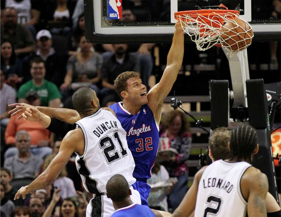 The Spurs' Tim Duncan (21) attempts to defend a dunk by Los Angeles Clippers' Blake Griffin (32) in the first quarter at the AT&T Center on Friday, Mar. 29, 2013. Photo: Kin Man Hui, San Antonio Express-News / © 2012 San Antonio Express-News