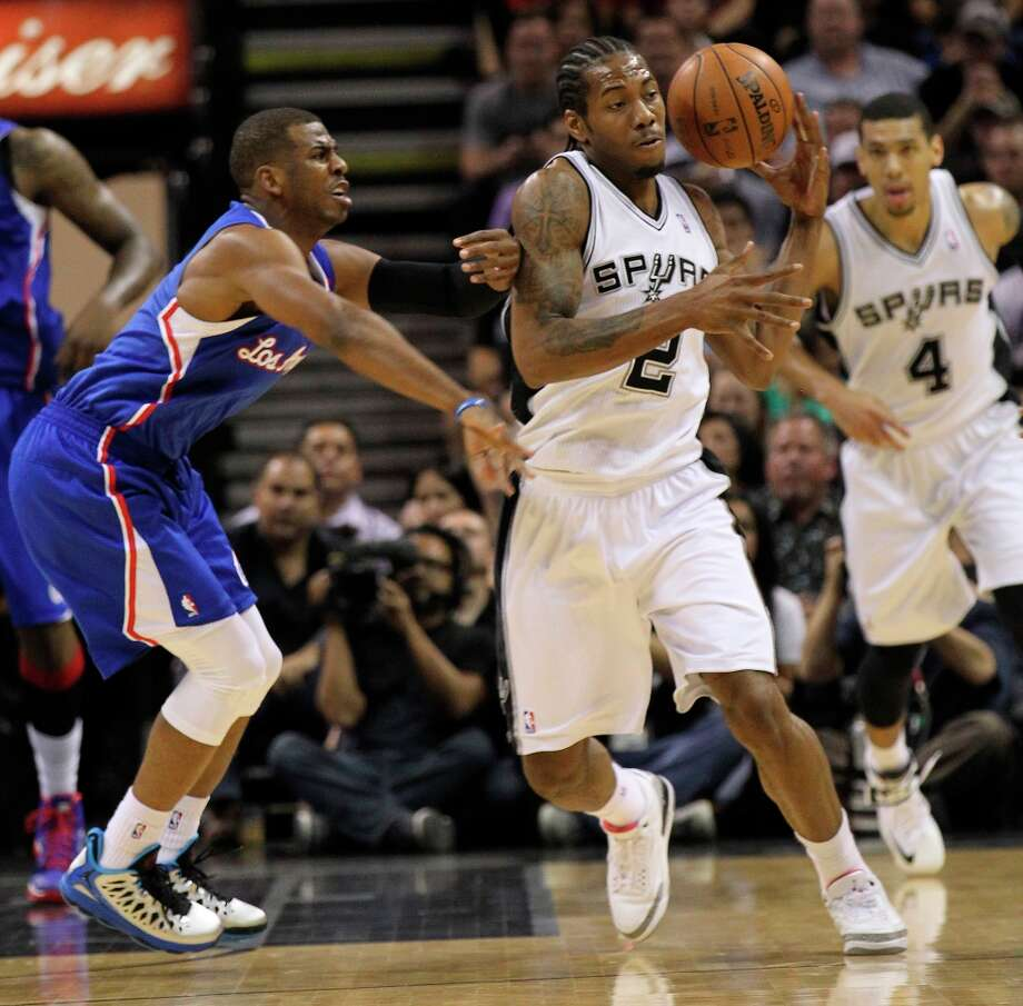 The Spurs' Kawhi Leonard (2) steals the ball from Los Angeles Clippers' Chris Paul (3) in the first quarter at the AT&T Center on Friday, Mar. 29, 2013. Photo: Kin Man Hui, San Antonio Express-News / © 2012 San Antonio Express-News