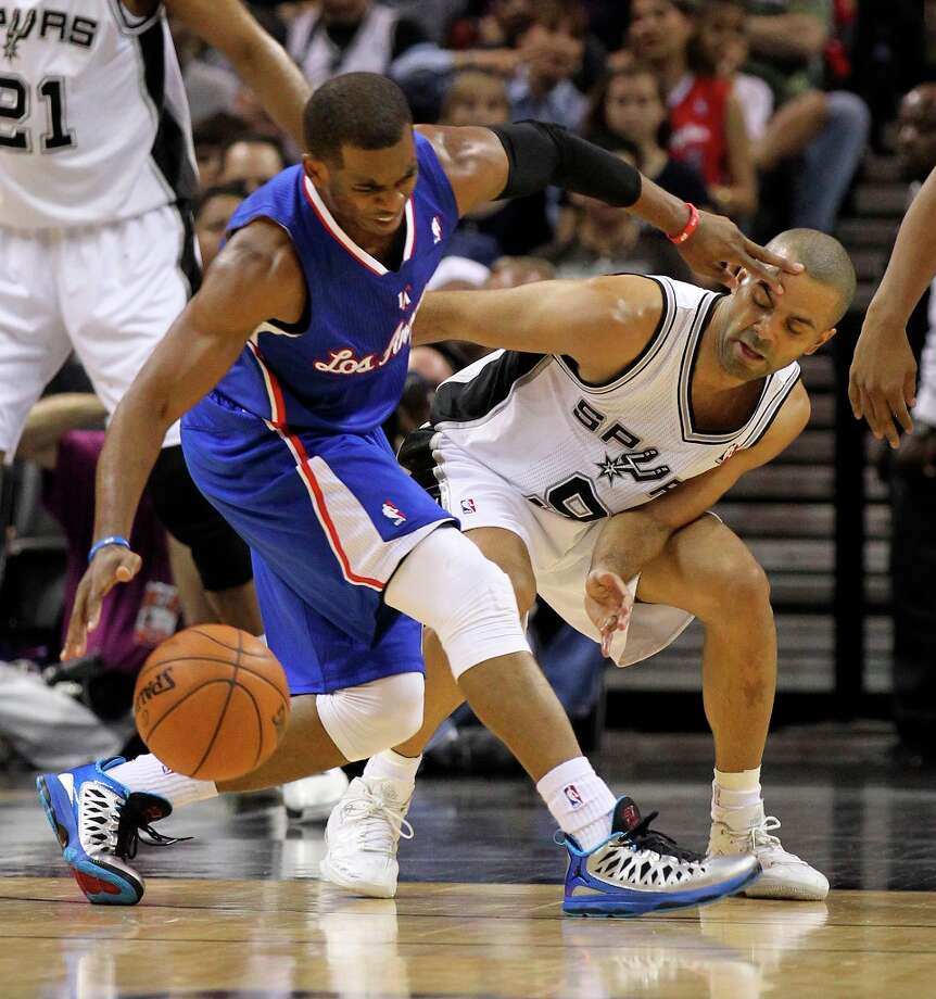 The Spurs' Tony Parker (9) defends against Los Angeles Clippers' Chris Paul (03) in the first quarter at the AT&T Center on Friday, Mar. 29, 2013. Photo: Kin Man Hui, San Antonio Express-News / © 2012 San Antonio Express-News