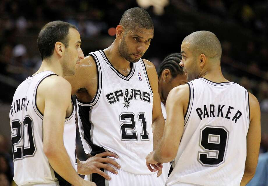 The Spurs' Tim Duncan (21), Manu Ginobili (20) and Tony Parker (9) chat during a timeout in the game against the Los Angeles Clippers in the first quarter at the AT&T Center on Friday, Mar. 29, 2013. Photo: Kin Man Hui, San Antonio Express-News / © 2012 San Antonio Express-News