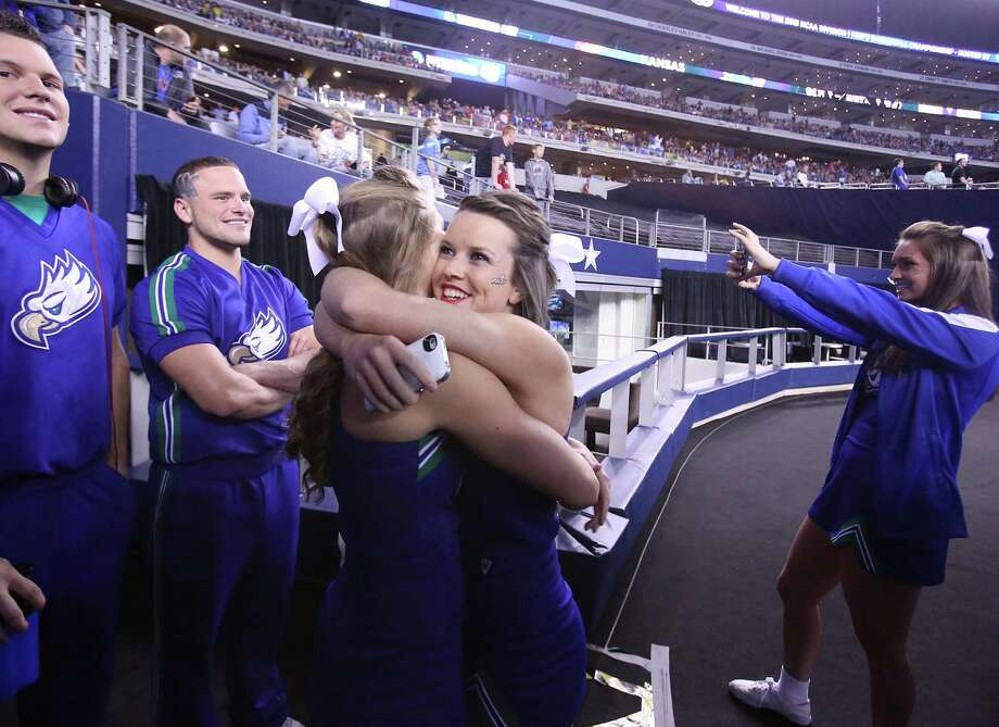 Florida Gulf Coast University cheerleaders drink in the moment as they step into the arena before the start of play against Florida in the NCAA Tournament's Sweet 16 game at Cowboys Stadium in Arlington, Texas, on Friday, March 29, 2013. (Stephen M. Dowell/Orlando Sentinel/MCT) Photo: Stephen M. Dowell, McClatchy-Tribune News Service / Orlando Sentinel