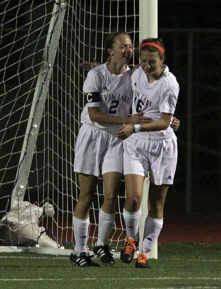 Seven Lakes 4, Bellaire 1Seven Lakes' Sarah Eads left, and Lauren Harrington right, celebrate after Eads scored a goal against  Bellaire during the second half of a Class 5A bi-district girls soccer playoff game at Seven Lakes High School Friday, March 29, 2013, in Katy . Photo: James Nielsen, Houston Chronicle / © 2013 Houston Chronicle