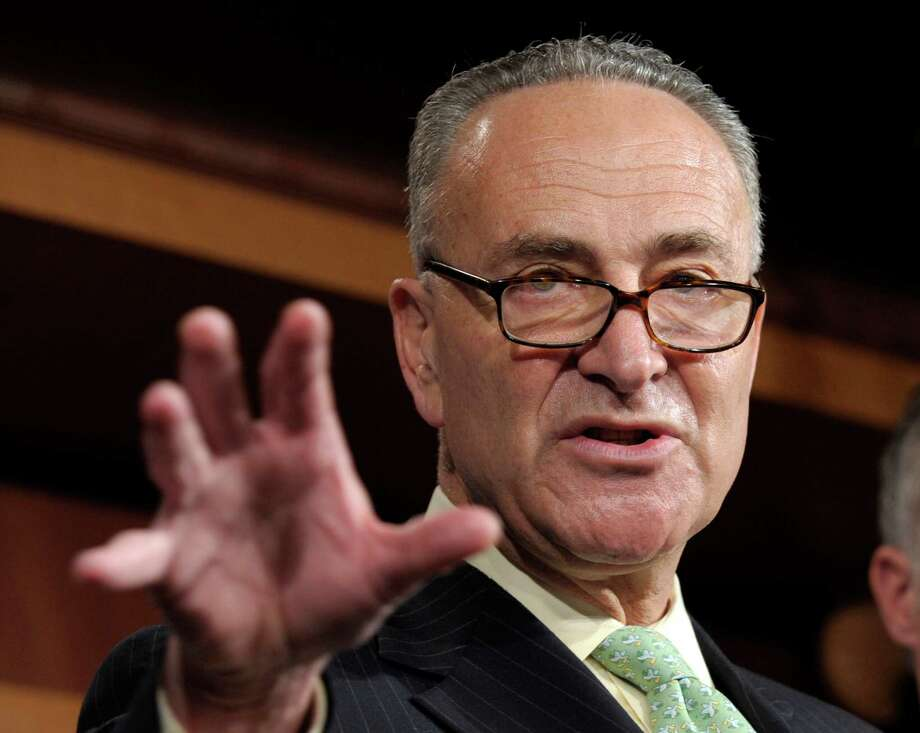 "FILE - In this May 17, 2012 file photo, Sen. Charles Schumer, D-N.Y. gestures during a news conference on Capitol Hill in Washington. Big business and major labor unions appeared ready Friday, March 29, 2013 to end a fight over a new low-skilled worker program that had threatened to upend negotiations on a sweeping immigration bill in the Senate providing a pathway to citizenship for 11 million immigrants already in the U.S.  Schumer, who's been brokering talks between the AFL-CIO and the Chamber of Commerce, said in a statement that negotiators are ""very close, closer than we have ever been, and we are very optimistic."" He said there were still a few issues remaining. (AP Photo/Susan Walsh, File) Photo: Susan Walsh"