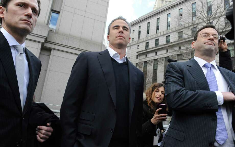 Michael Steinberg, center, exits Manhattan federal court with his attorney Barry Berke, Friday,March 29. 2013, in New York. A senior portfolio manager for SAC Capital Advisors, one of the largest U.S. hedge funds was arrested Friday, accused of making $1.4 million illegally in a widening insider trading probe involving an investment company founded by billionaire businessman Steven A. Cohen. (AP Photo/Louis Lanzano) Photo: Louis Lanzano
