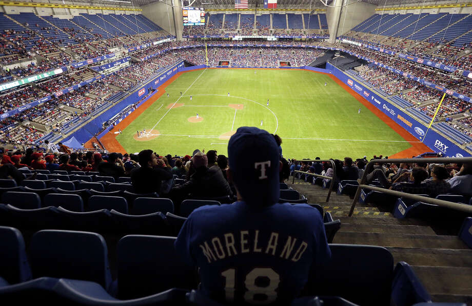 Baseball fan John Heridia watches the Texas Rangers and San Diego Padres exhibition baseball game part of the ÒBig League WeekendÓ Friday March 29, 2013 at the Alamodome. Photo: Edward A. Ornelas, San Antonio Express-News / © 2013 San Antonio Express-News