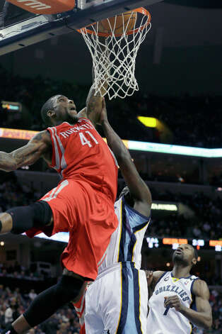 March 29: Grizzlies 103, Rockets 94Thomas Robinson of the Rockets goes to the basket against Zach Randolph of the Grizzlies. Photo: Danny Johnston