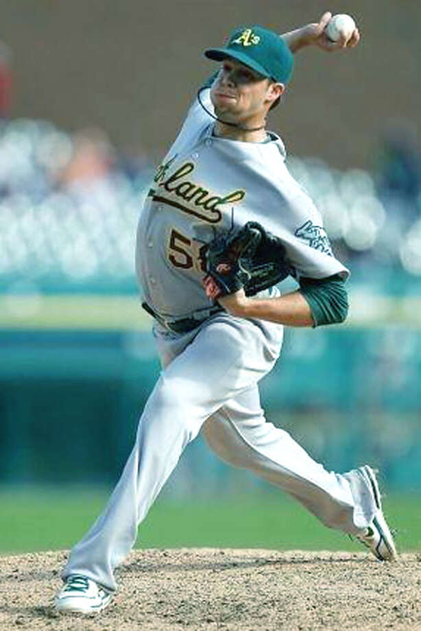 The middle relief pitching of Shepaug Valley High graduate Evan Scribner of Washington contributed mightily to the playoff run of major league baseball's Oakland A's in late summer and early fall. 2012 Photo: Contributed Photo