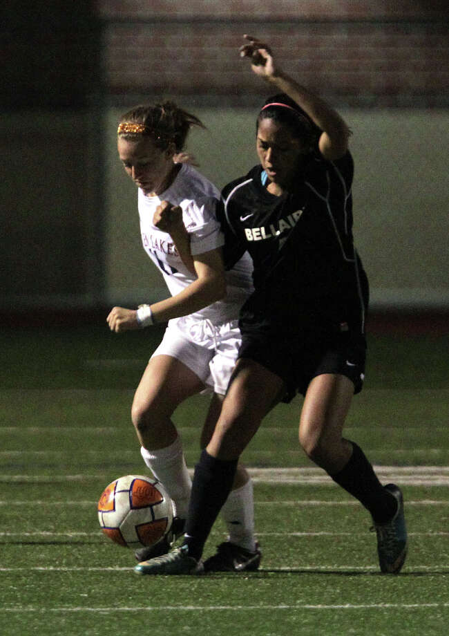 Seven Lakes' Caitlyn Mortus left, and Bellaire's Sara Mirza right, during the second half of a Class 5A bi-district girls soccer playoff game at Seven Lakes High School Friday, March 29, 2013, in Katy . Photo: James Nielsen, Houston Chronicle / © 2013 Houston Chronicle