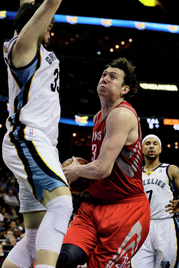 Omer Asik of the Rockets tries to move the ball between Jerryd Bayless and Marc Gasol of the Grizzlies. Photo: Danny Johnston