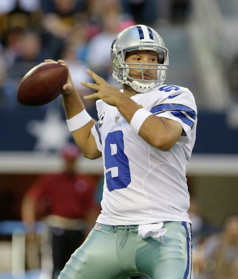 Quarterback Tony Romo has a chance to end his career with the Cowboys after signing an extension. Photo: Tony Gutierrez, STF / AP