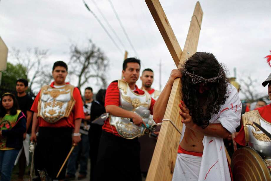 Jesus, played by Saul Perez, is followed by a procession of the church, Friday, March 29, 2013, near Our Lady of Guadalupe Catholic church in Houston, Texas. Photo: TODD SPOTH, For The Chronicle / Todd Spoth