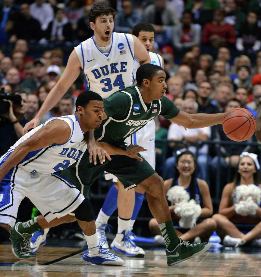 Duke guard Quinn Cook (2) tries to contain Michigan State guard Gary Harris (14) in the first half of an NCAA Men's Basketball Tournament Midwest Regional semifinal at Lucas Oil Stadium in Indianapolis, Indiana, Friday, March 29, 2013. (Chuck Liddy/Raleigh News & Observer/MCT) Photo: Chuck Liddy, McClatchy-Tribune News Service / Raleigh News & Observer
