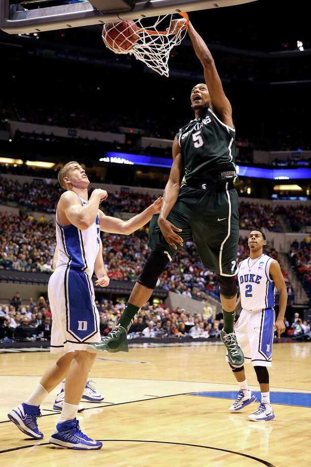 INDIANAPOLIS, IN - MARCH 29:  Adreian Payne #5 of the Michigan State Spartans dunks in the first half against Mason Plumlee #5 of the Duke Blue Devils during the Midwest Region Semifinal round of the 2013 NCAA Men's Basketball Tournament at Lucas Oil Stadium on March 29, 2013 in Indianapolis, Indiana. Photo: Andy Lyons, Getty Images / 2013 Getty Images