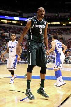 INDIANAPOLIS, IN - MARCH 29:  Adreian Payne #5 of the Michigan State Spartans reacts after he dunked in the first half against the Duke Blue Devils during the Midwest Region Semifinal round of the 2013 NCAA Men's Basketball Tournament at Lucas Oil Stadium on March 29, 2013 in Indianapolis, Indiana. Photo: Andy Lyons, Getty Images / 2013 Getty Images