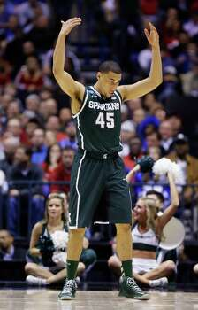 Michigan State guard Denzel Valentine (45) reacts during the first half of a regional semifinal against Duke in the NCAA college basketball tournament, Friday, March 29, 2013, in Indianapolis. (AP Photo/Michael Conroy) Photo: Michael Conroy, Associated Press / AP