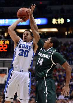Duke guard Seth Curry (30) is fouled by Michigan State guard Gary Harris (14) in the first half of an NCAA Men's Basketball Tournament Midwest Regional semifinal at Lucas Oil Stadium in Indianapolis, Indiana, Friday, March 29, 2013. (Chuck Liddy/Raleigh News & Observer/MCT) Photo: Chuck Liddy, McClatchy-Tribune News Service / Raleigh News & Observer