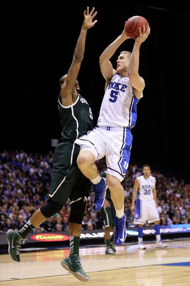 INDIANAPOLIS, IN - MARCH 29:  Mason Plumlee #5 of the Duke Blue Devils drives for a shot attempt in the first half against Adreian Payne #5 of the Michigan State Spartans during the Midwest Region Semifinal round of the 2013 NCAA Men's Basketball Tournament at Lucas Oil Stadium on March 29, 2013 in Indianapolis, Indiana. Photo: Streeter Lecka, Getty Images / 2013 Getty Images