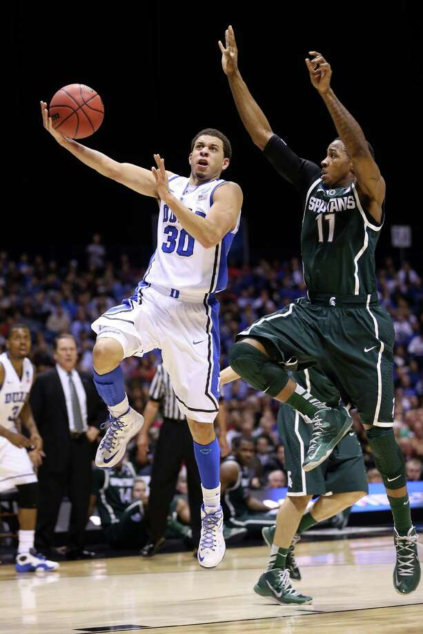 INDIANAPOLIS, IN - MARCH 29:  Seth Curry #30 of the Duke Blue Devils drives for a shot attempt in the first half against Keith Appling #11 of the Michigan State Spartans during the Midwest Region Semifinal round of the 2013 NCAA Men's Basketball Tournament at Lucas Oil Stadium on March 29, 2013 in Indianapolis, Indiana. Photo: Streeter Lecka, Getty Images / 2013 Getty Images