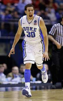 Duke guard Seth Curry (30) reacts during the first half of a regional semifinal against Michigan State in the NCAA college basketball tournament, Friday, March 29, 2013, in Indianapolis. (AP Photo/Michael Conroy) Photo: Michael Conroy, Associated Press / AP