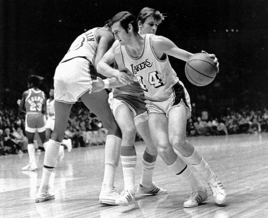 Guard Jerry West, shown using a screen from Wilt Chamberlain, is a connection between the 1971-72 Lakers and the current Warriors. He now is an executive with Golden State. Photo: AP File Photo 1971, Associated Press