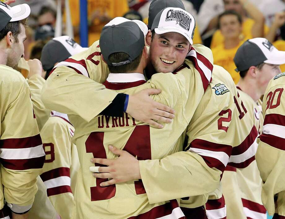 TAMPA, FL - APRIL 07:  Defenseman Brian Dumoulin #2 of the Boston College Eagles hugs Brooks Dyroff #14 after defeating the Ferris State Bulldogs during the NCAA Division 1 Men's Hockey Championship Game at the Tampa Bay Times Forum on April 7, 2012 in Tampa, Florida.  (Photo by J. Meric/Getty Images) Photo: J. Meric / 2012 Getty Images