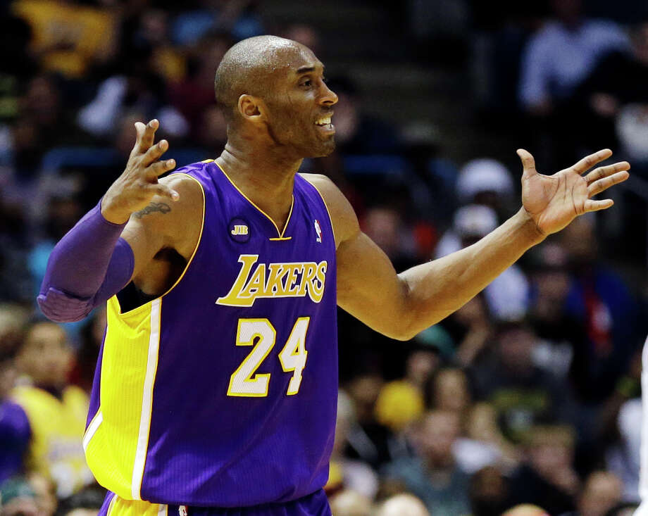 Los Angeles Lakers' Kobe Bryant argues a call against the Milwaukee Bucks during the second half of an NBA basketball game, Thursday, March 28, 2013, in Milwaukee. The Bucks won 113-103.(AP Photo/Jeffrey Phelps) Photo: JEFFREY PHELPS