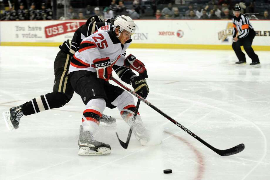 Devils' David Wohlberg, center, loses the puck as Bears' Garrett Stafford defends during their hockey game on Friday, March 29, 2013, at Times Union Center in Albany, N.Y. (Cindy Schultz / Times Union) Photo: Cindy Schultz / 00021748A