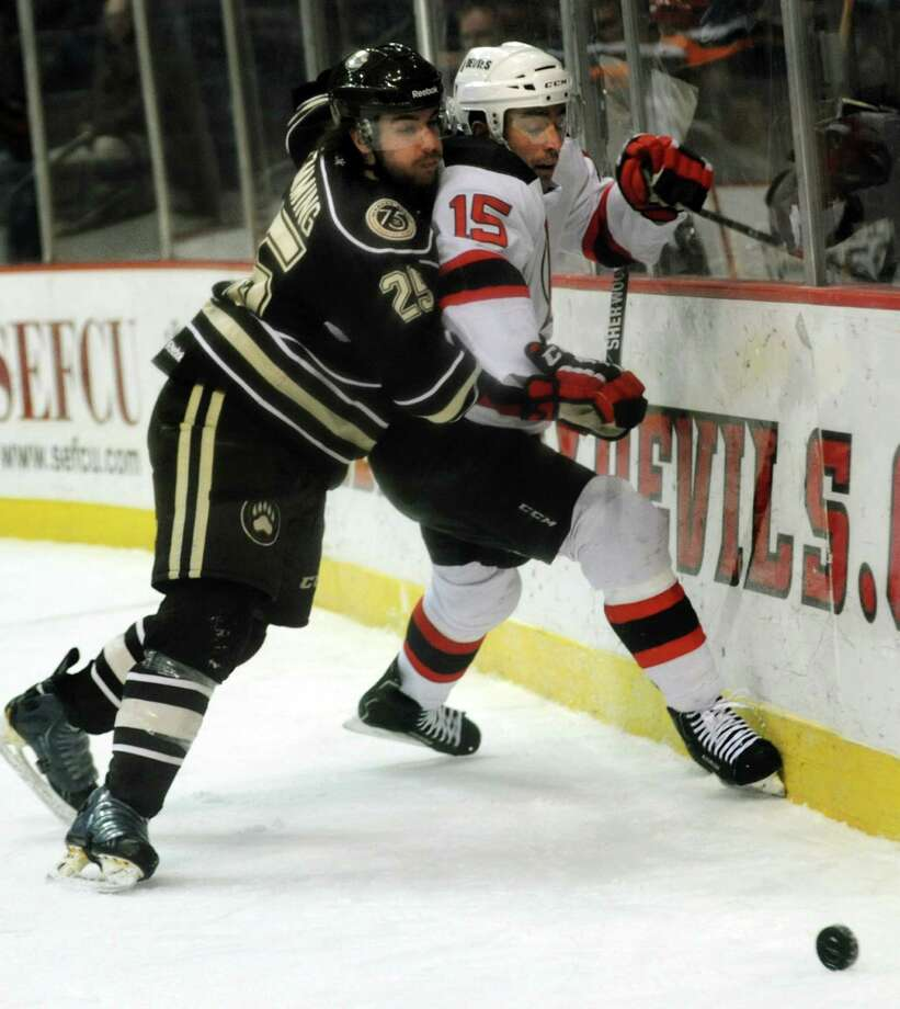 Devils' Steve Zalewski, right, struggles for a loose puck with Bears' Brett Flemming during their hockey game on Friday, March 29, 2013, at Times Union Center in Albany, N.Y. (Cindy Schultz / Times Union) Photo: Cindy Schultz / 00021748A