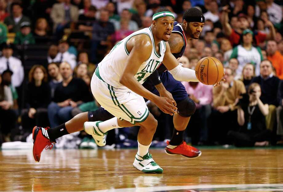 BOSTON, MA - MARCH 29:  Paul Pierce #34 of the Boston Celtics dribbles the ball past Josh Smith #5 of the Atlanta Hawks during the game on March 29, 2013 at TD Garden in Boston, Massachusetts. NOTE TO USER: User expressly acknowledges and agrees that, by downloading and or using this photograph, User is consenting to the terms and conditions of the Getty Images License Agreement. (Photo by Jared Wickerham/Getty Images) Photo: Jared Wickerham